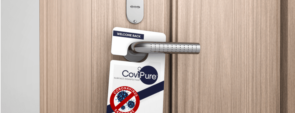 Covipure cleaning tag on hotel door handle
